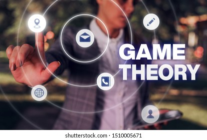 Conceptual hand writing showing Game Theory. Business photo showcasing branch of mathematics concerned with analysis of strategies.