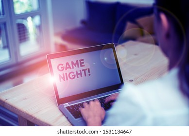 Conceptual hand writing showing Game Night. Business photo text usually its called on adult play dates like poker with friends woman with laptop smartphone and office supplies technology.