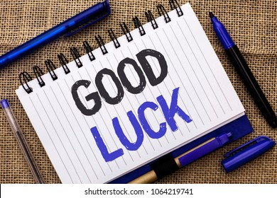 Conceptual hand writing showing Good Luck. Business photo showcasing Lucky Greeting Wish Fortune Chance Success Feelings Blissful written on Notebook Book on jute background Pens next to it.