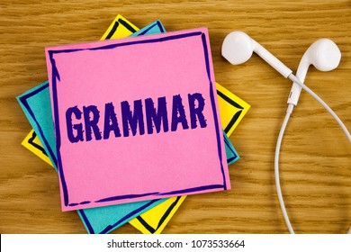 Conceptual hand writing showing Grammar. Business photo showcasing System and Structure of a Language Correct Proper Writing Rules written on Sticky Note Paper on wooden background Handsfree.