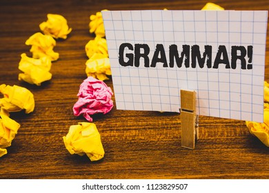 Conceptual hand writing showing Grammar Motivational Call. Business photo text System and Structure of a Language Writing Rules Clothespin hold holding notebook paper crumpled papers ideas.