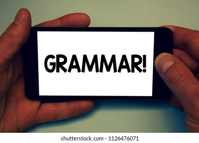 Conceptual hand writing showing Grammar Motivational Call. Business photo showcasing System and Structure of a Language Writing Rules Man hold holding cell phone message application intention.