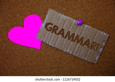 Conceptual hand writing showing Grammar Motivational Call. Business photo text System and Structure of a Language Writing Rules Brown old damaged paperboard ideas pink heart cork background.