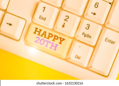 Conceptual hand writing showing Happy 20Th. Business photo text a joyful occasion for special event to mark the 20th year White pc keyboard with note paper above the white background.