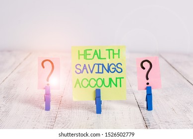 Conceptual hand writing showing Health Savings Account. Business photo text users with High Deductible Health Insurance Policy Crumbling sheet with paper clips placed on the wooden table.