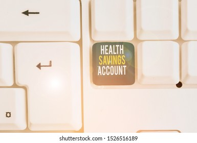Conceptual hand writing showing Health Savings Account. Business photo showcasing users with High Deductible Health Insurance Policy White pc keyboard with note paper above the white background.