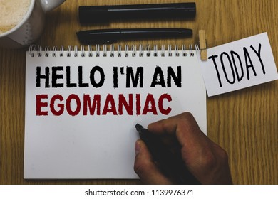 Conceptual hand writing showing Hello I am An Egomaniac. Business photo text Selfish Egocentric Narcissist Self-centered Ego Written on paper hand hold pen clipper grip sticky note black pen.