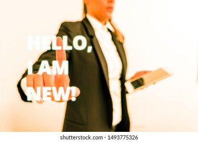 Conceptual hand writing showing Hello I Am New. Business photo text used as greeting or to begin telephone conversation Digital business in black suite concept with business woman.