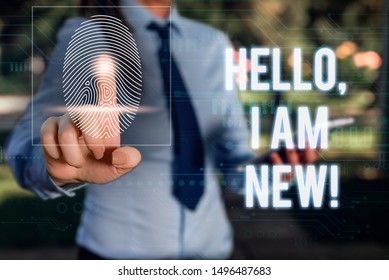 Conceptual hand writing showing Hello I Am New. Business photo showcasing used as greeting or to begin telephone conversation Woman wear work suit presenting presentation smart device.