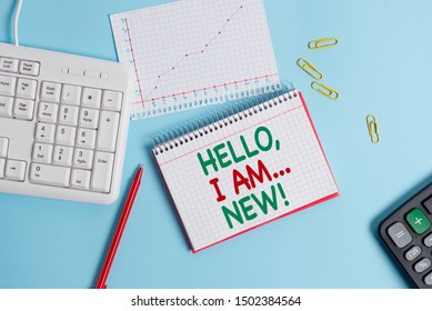 Conceptual hand writing showing Hello I Am New. Business photo text used greeting or begin telephone conversation Paper blue keyboard office study notebook chart numbers memo.