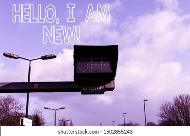 Conceptual hand writing showing Hello I Am New. Business photo text used as greeting or to begin telephone conversation Front view lamp post with two lamps sunny day sky background.
