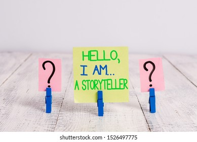 Conceptual hand writing showing Hello I Am A Storyteller. Business photo text introducing yourself as novels article writer Crumbling sheet with paper clips placed on the wooden table.