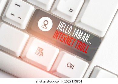 Conceptual hand writing showing Hello I Am An Internet Troll. Business photo text Social media troubles discussions arguments White pc keyboard with note paper above the white background.