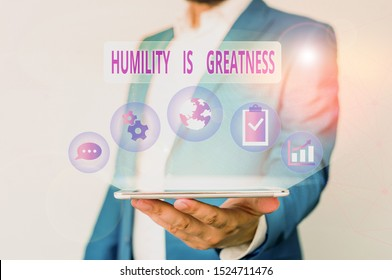 Conceptual hand writing showing Humility Is Greatness. Business photo text being Humble is a Virtue not to Feel overly Superior Male human wear formal suit presenting using smart device.