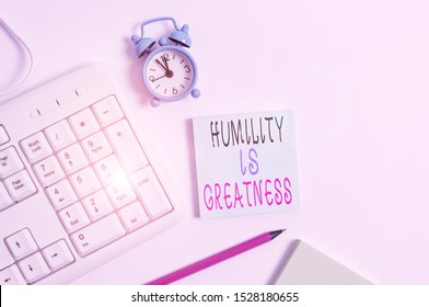 Conceptual hand writing showing Humility Is Greatness. Business photo showcasing being Humble is a Virtue not to Feel overly Superior Keyboard with empty note paper and pencil white background.