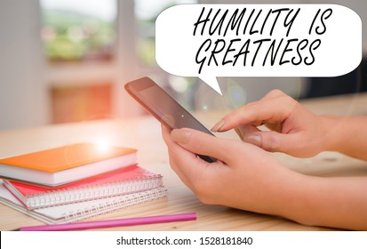 Conceptual hand writing showing Humility Is Greatness. Business photo text being Humble is a Virtue not to Feel overly Superior woman using smartphone and technological devices inside the home.