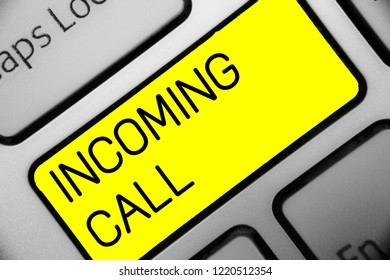 Conceptual hand writing showing Incoming Call. Business photo text Inbound Received Caller ID Telephone Voicemail Vidcall Keyboard yellow key computer computing reflection document.