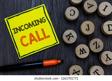 Conceptual hand writing showing Incoming Call. Business photo showcasing Inbound Received Caller ID Telephone Voicemail Vidcall Yellow paper circle Marker express ideas wooden background.