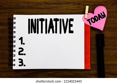 Conceptual hand writing showing Initiative. Business photo text Ability to assess and initiate things independently Motivation Open notebook page markers holding paper heart wooden background.