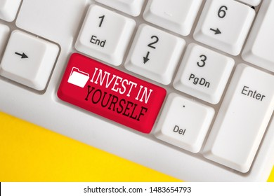Conceptual hand writing showing Invest In Yourself. Business photo showcasing learn new things or materials thus making your lot better White pc keyboard with note paper above the white background.