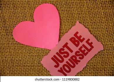 Conceptual hand writing showing Just Be Yourself. Business photo text Self Attitude Confidence True Confident Honesty Motivation Text pink torn paper note heart love message letter.
