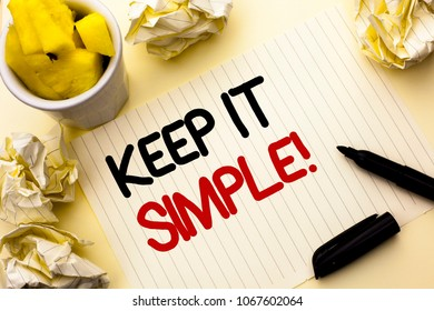 Conceptual hand writing showing Keep It Simple Motivational Call. Business photo showcasing Simplify Things Easy Clear Concise Ideas written on Notebook Paper on the plain background Cup Marker