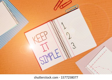 Conceptual hand writing showing Keep It Simple. Business photo text Easy to toss around Understandable Generic terminology Striped paperboard cardboard office study supplies chart.