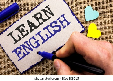 Conceptual hand writing showing Learn English. Business photo showcasing Study another Language Learn Something Foreign Communication written on Sticky Note on the jute bakground with Love Hearts.