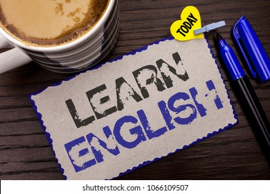 Conceptual hand writing showing Learn English. Business photo showcasing Study another Language Learn Something Foreign Communication written on Sticky Note wooden background Today Coffee Marker.