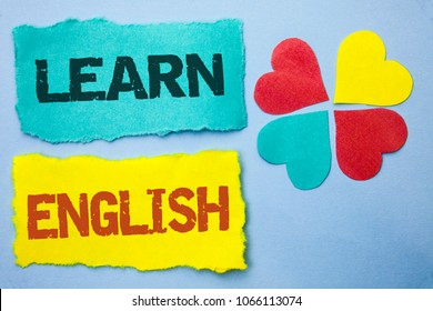 Conceptual hand writing showing Learn English. Business photo showcasing Study another Language Learn Something Foreign Communication written on Tear Papers on the Sky Blue background Hearts.