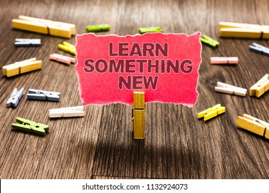 Conceptual hand writing showing Learn Something New. Business photo text being taught new subject activity Knowledge or sport Clips spread woody table learn study things class schooling.