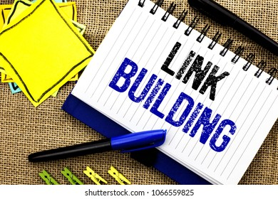 Conceptual hand writing showing Link Building. Business photo showcasing Process of acquiring hyperlinks from other websites Connection written on Notebook Book on the jute background Clips and Pens