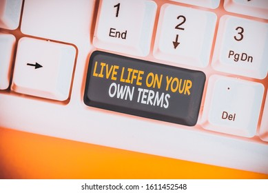 Conceptual hand writing showing Live Life On Your Own Terms. Business photo showcasing Give yourself guidelines for a good living White pc keyboard with note paper above the white background.
