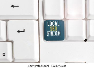 Conceptual hand writing showing Local Seo Optimization. Business photo showcasing increase Search Visibility to Rank on Top list White pc keyboard with note paper above the white background.