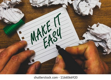 Conceptual hand writing showing Make It Easy. Business photo text Smart approach Effortless Free from worries or difficulties Man holding marker notebook page crumpled papers several tries.