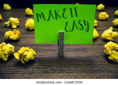 Conceptual hand writing showing Make It Easy. Business photo text Smart approach Effortless Free from worries or difficulties Clothespin holding green paper note crumpled papers mistakes.