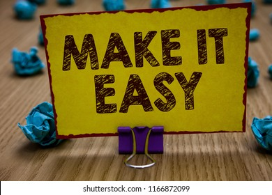 Conceptual hand writing showing Make It Easy. Business photo showcasing Smart approach Effortless Free from worries or difficulties Clip holding yellow paper note crumpled papers several tries.