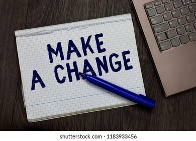Conceptual hand writing showing Make A Change. Business photo text Create a Difference Alteration Have an Effect Metamorphose Open notebook squared page black marker computer wooden background.
