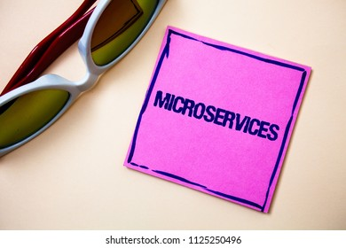 Conceptual hand writing showing Microservices. Business photo text Software development technique Decomposing an application Sticky cards googles glasses office smart script work eye sight.