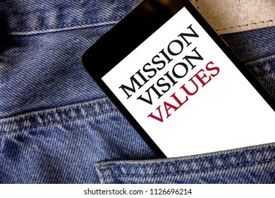 Conceptual hand writing showing Mission Vison Values. Business photo text planning for future improvement Career Right decisions Cell phone white screen message application wicker background.