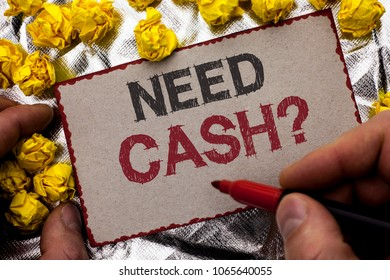 Conceptual hand writing showing Need Cash Question. Business photo showcasing Wealth Question Needy Currency Money Advice Conceptual written by Man Holding Marker on Cardboard textured background