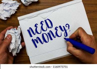 Conceptual hand writing showing Need Money question. Business photo showcasing asking someone if he needs cash or bouns Get loan Man holding marker notebook crumpled papers ripped pages.