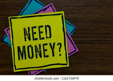 Conceptual hand writing showing Need Money question. Business photo text asking someone if he needs cash or bouns Get loan Paper notes Important reminders Express messages Wooden background.