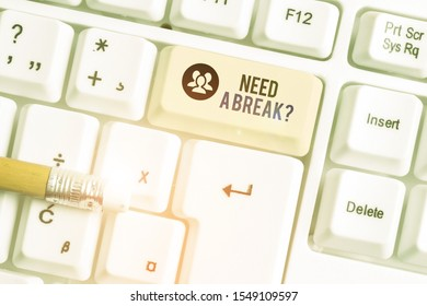 Conceptual hand writing showing Need A Brake Question. Business photo showcasing More Time to Relax Chill Out Freedom Stress Free White pc keyboard with note paper above the white background.