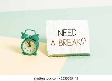 Conceptual hand writing showing Need A Brake Question. Business photo text More Time to Relax Chill Out Freedom Stress Free Alarm clock beside a Paper sheet placed on pastel backdrop.
