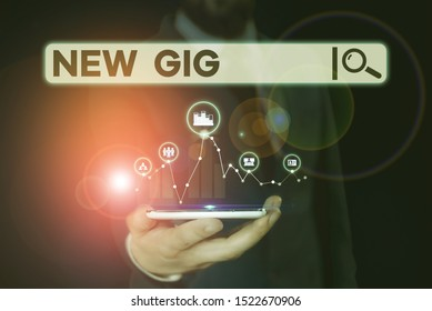 Conceptual hand writing showing New Gig. Business photo showcasing getting job Attending live Concert Gigabyte Freelancer offer Male wear formal suit presenting presentation smart device.