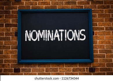 Conceptual hand writing showing Nominations. Business photo showcasing Suggestions of someone or something for a job position or prize Framed hang black board study class brick wall background.