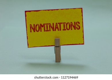 Conceptual hand writing showing Nominations. Business photo text Suggestions of someone or something for a job position or prize Display yellow sticky card convey messages idea notice office.