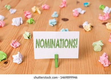 Conceptual hand writing showing Nominations. Business photo showcasing action of nominating or state being nominated for prize Colored crumpled papers wooden floor background clothespin.