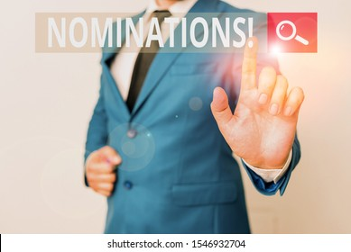 Conceptual hand writing showing Nominations. Business photo text action of nominating or state being nominated for prize Businessman with pointing finger in front of him.